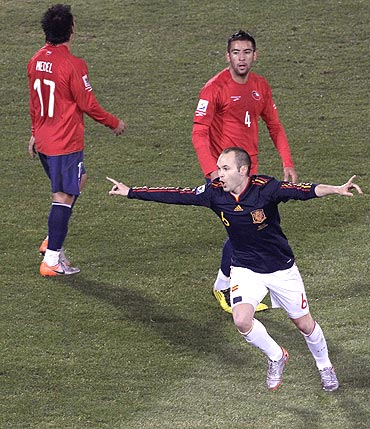 Spain's Andres Iniesta (right) celebrates after scoring against Chile