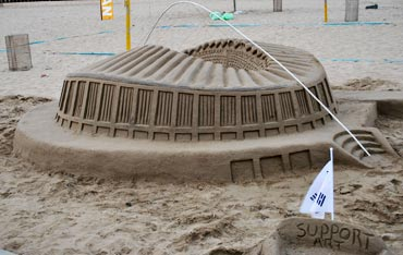 A sand sculpture of Moses Mabhida stadium