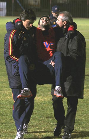 Spain's Raul Albiol is carried off after injuring  himself during a training session in Potchefstroom