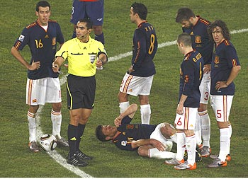 Spain's Xabi  Alonso lies on the ground after being injured during the last group  match against Mexico