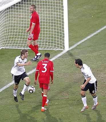 Thomas Mueller (left) celebrates with teammate Olic after scoring against England