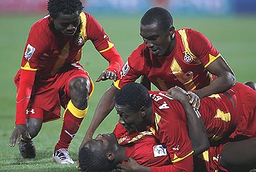 Ghana players celebrate after winning their match against USA