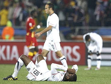 United States' Edu and Langdon Donavan react after their loss to Ghana
