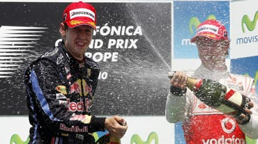 Sebastian Vettel celebrates with Jeson Button