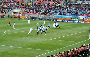 A South Korean player takes a free-kick