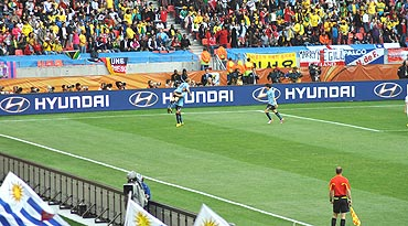 Forlan gets hoisted for setting up the first goal