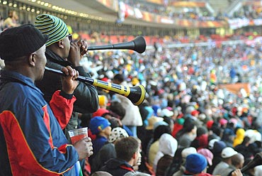 Fans cheer their teams by blowing the vuvuzelas