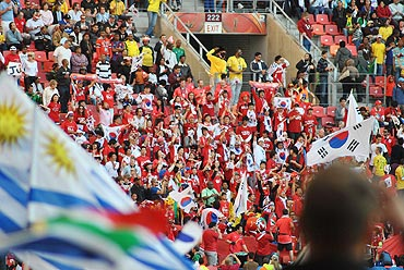 South Korean fans wave their flags