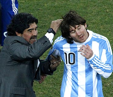 Argentina coach Diego Maradona celebrates with Lionel Messi