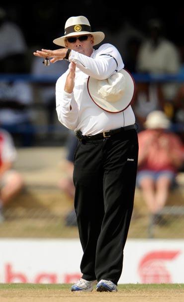 Umpire Daryl Harper calls for a TV referral