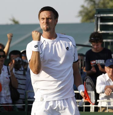 Robin Soderling reacts after beating David Ferrer