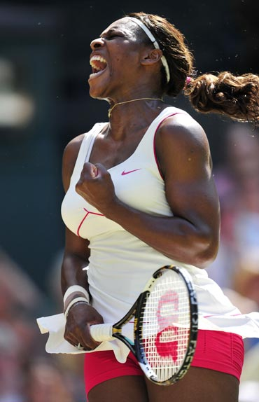Serena Williams celebrates after beating Maria Sharapova