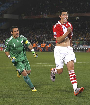 Paraguay's Cardozo celebrates after scoring the  winning penalty after a penalty shootout