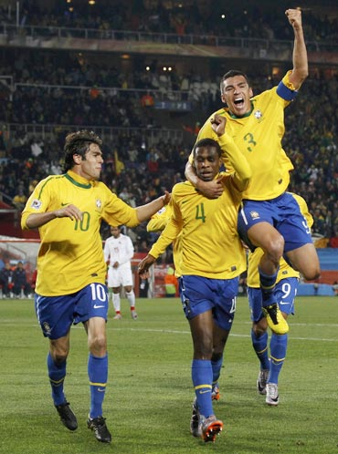 Juan celebrates after scoring the opening goal for Brazil