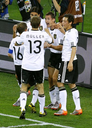 Klose celebrates with team-mates