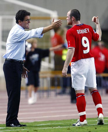 Wayne Rooney speaks to England manager Fabio Capello
