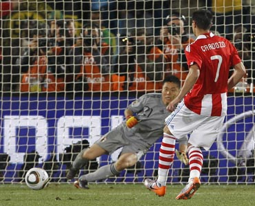 Paraguay's Cardozo scores the winning penalty against Japan's Eiji Kawashima during a penalty shootout