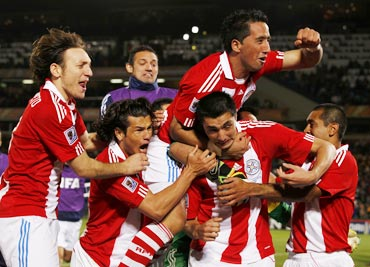 Paraguay's Cardozo celebrates after scoring the winning penalty