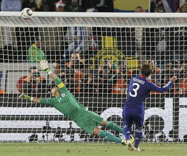 Japan's Komano hits the crossbar during a penalty shootout against Paraguay