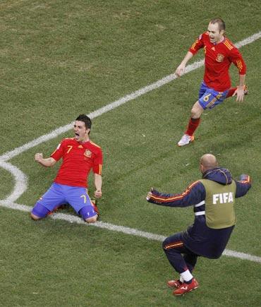 David Villa celebrates after scoring against Portugal