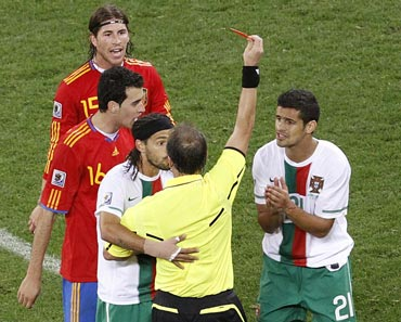 Portugal's Ricardo Costa is shown the red card by referee Hector Baldassi