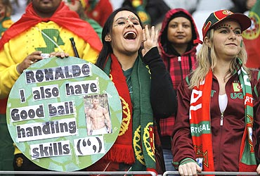 A fan displays a naughty placard directed towards Ronaldo