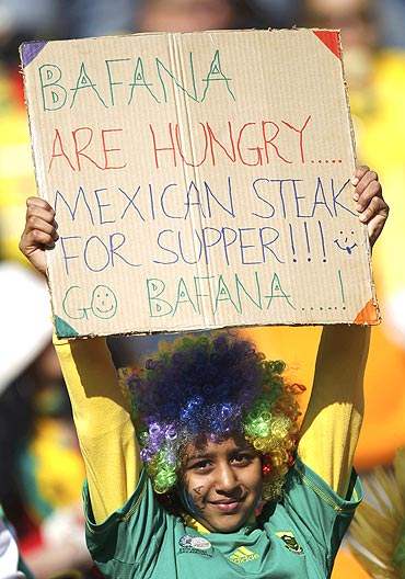 A South African fan holds an interesting placard
