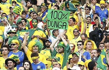 Brazilian fans show their support to coach Dunga