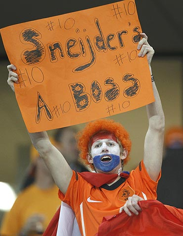A Dutch fan cheers for Wesley Sneijder