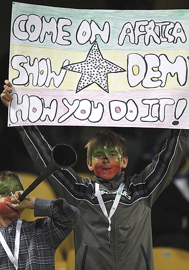 A young fan backs the Ghana team during the match against United States