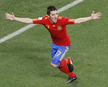 David Villa celebrates after scoring against Portugal