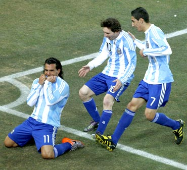 Carlos Tevez celebrates scoring a goal with team mates
