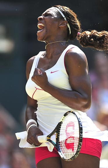 Serena Williams celebrates after celebrating her match