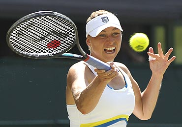 Vera Zvonareva returns to Kim Clijsters