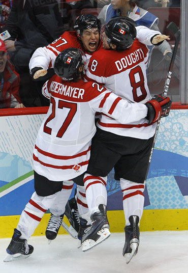 Canada's Sidney Crosby celebrates after scoring the winning goal against the US