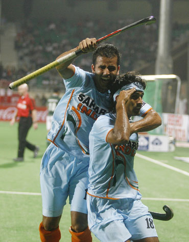 Shivendra Singh celebrates after scoring a goal