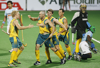 Australia's Glenn Turner celebrates the team's second goal during their match against India at the men's Hockey World Cup