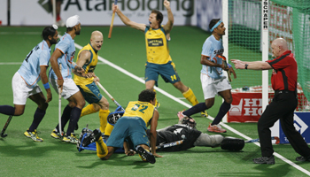 Australia's Hammond and Schubert celebrate after Abbott scored the third goal during their match against India