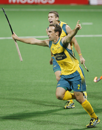 Australia's Liam De Young celebrates with his team mate Orchard after scoring the first goal during their match against India