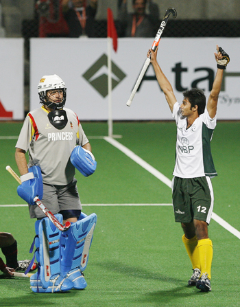 Pakistan's Abdul Haseem Khan celebrates after scoring the first goal as Spain's goal keeper Cortes watches during their match