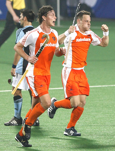 The Netherlands' Taeke Taekema (right) celebrates with team-mate Geert-Jan Derikx after scoring the third goal