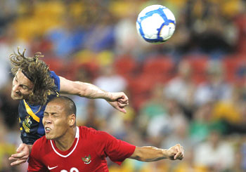 Australia's Josh Kennedy (left) and Indonesia's Nova Arianto are caught in an aerial challenge during their 2011 AFC Asian Cup qualifying match on Wednesday