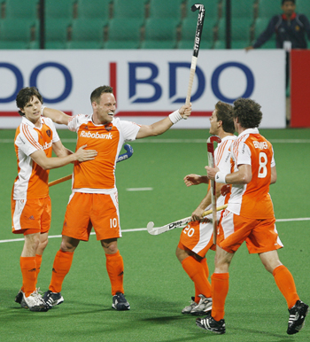 The Netherlands' defender Taeke Taekema celebrates with his team mates after scoring the team's second goal