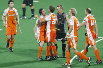 The Netherlands' Jeroen Hertzberger celebrates with teammates after scoring a goal against New Zealand