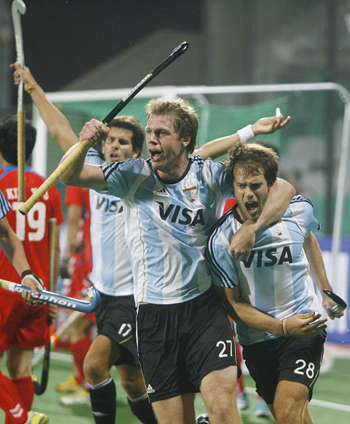 Argentina's Lopez, Rossi and Callioni celebrate the team's first goal during their match against South Korea