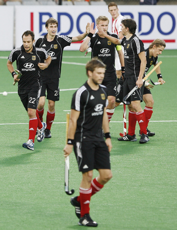 Germany's players celebrate their sixth goal during their match against Canada at the men's Hockey World Cup