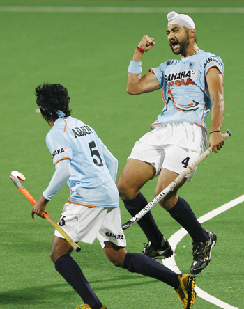 India's Sandeep Singh celebrates with his team mate Halappa after scoring the team's first goal during their match against Spain