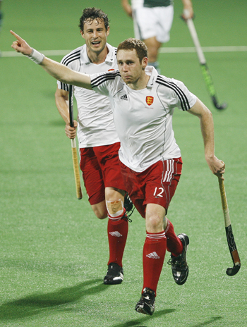 England's Clarke celebrates with his team mate Moore after scoring the team's first goal during their match