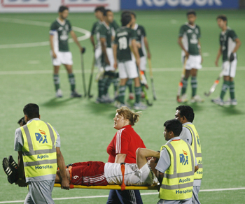 England's Mantell is carried on a stretcher after he got injured during their match against Pakistan