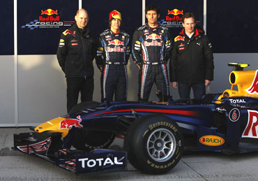 Red Bull team with the car